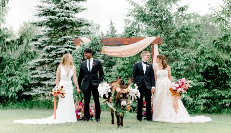 Two Couples Standing by Wedding Arch and Cute Donkey at Rustic Bohemian Wedding Styled Shoot