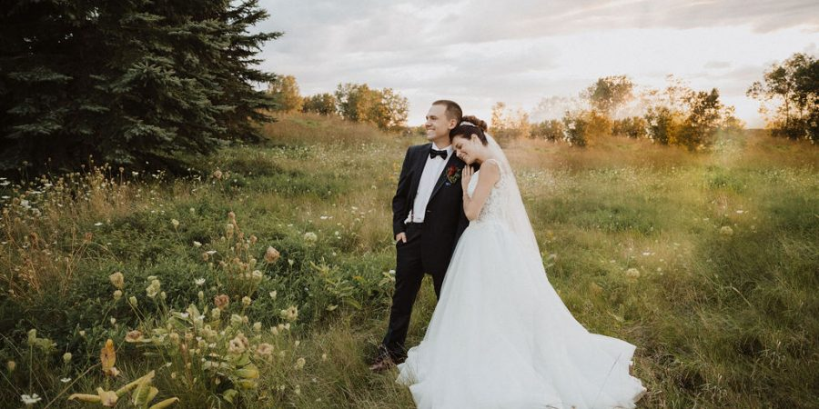 Bride Wearing Ball Gown Wedding Dress and Resting Head on Groom's Shoulder